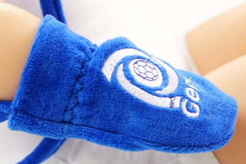 Custom baby gloves with embroidered crest