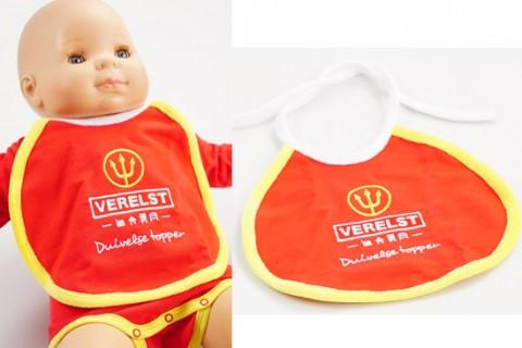Custom baby bib displayed on doll