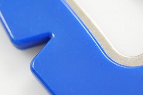 Custom keyring shirt design detail of bottle opener